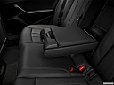 2018 Audi A4 Premium 2.0 TFSI ultra, rear center console with closed lid from driver's side looking down.