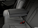 2018 Audi Q3 Premium 2.0 TFSI, rear center console with closed lid from driver's side looking down.