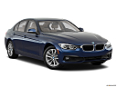 2018 BMW 3-series 320i, front passenger 3/4 w/ wheels turned.