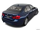 2018 BMW 3-series 320i, rear 3/4 angle view.