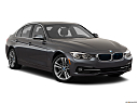 2018 BMW 3-series 330e iPerformance, front passenger 3/4 w/ wheels turned.