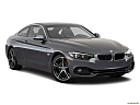 2018 BMW 4-series 430i, front passenger 3/4 w/ wheels turned.