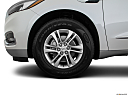 2018 Buick Enclave Essence, front drivers side wheel at profile.