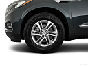 2018 Buick Enclave Premium, front drivers side wheel at profile.