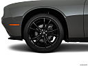 2018 Dodge Challenger SXT, front drivers side wheel at profile.