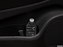 2018 Dodge Durango GT, second row side cup holder with coffee prop, or second row door cup holder with water bottle.