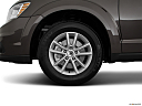 2018 Dodge Journey SXT, front drivers side wheel at profile.