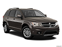 2018 Dodge Journey SXT, front passenger 3/4 w/ wheels turned.
