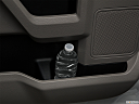 2018 Ford F-150 XLT, second row side cup holder with coffee prop, or second row door cup holder with water bottle.