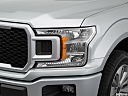 2018 Ford F-150 XL, drivers side headlight.