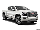 2018 GMC Sierra 1500 Denali, front passenger 3/4 w/ wheels turned.
