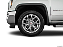 2018 GMC Sierra 1500 SLT, front drivers side wheel at profile.