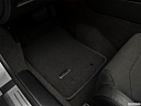 2018 Jaguar F-Type, driver's floor mat and pedals. mid-seat level from outside looking in.