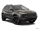 2018 Jeep Cherokee Trailhawk, front passenger 3/4 w/ wheels turned.