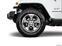 2018 Jeep Wrangler Sahara, front drivers side wheel at profile.
