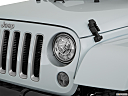 2018 Jeep Wrangler Sahara, drivers side headlight.