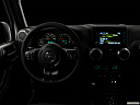 "2018 Jeep Wrangler Sahara, centered wide dash shot - ""night"" shot."