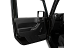 2018 Jeep Wrangler Sport, inside of driver's side open door, window open.