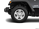 2018 Jeep Wrangler Sport, front drivers side wheel at profile.