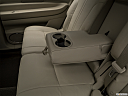 2018 Lincoln MKT Reserve, rear center console with closed lid from driver's side looking down.