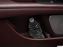 2018 Lincoln MKZ Black Label, second row side cup holder with coffee prop, or second row door cup holder with water bottle.