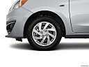 2018 Mitsubishi Mirage SE, front drivers side wheel at profile.