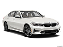 2019 BMW 3-series 330i, front passenger 3/4 w/ wheels turned.