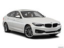 2019 BMW 3-series 340i xDrive Gran Turismo, front passenger 3/4 w/ wheels turned.