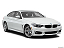 2019 BMW 4-series 430i Gran Coupe, front passenger 3/4 w/ wheels turned.