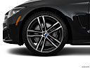 2019 BMW 4-series 440i Convertible, front drivers side wheel at profile.