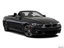 2019 BMW 4-series 440i Convertible, front passenger 3/4 w/ wheels turned.