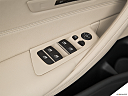2019 BMW 5-series 530i, driver's side inside window controls.
