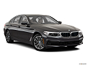 2019 BMW 5-series 530i, front passenger 3/4 w/ wheels turned.