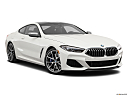 2019 BMW 8-series M850i xDrive, front passenger 3/4 w/ wheels turned.