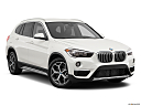 2019 BMW X1 xDrive28i, front passenger 3/4 w/ wheels turned.