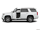 2019 Chevrolet Tahoe LT, driver's side profile with drivers side door open.