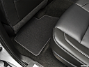 2019 Chevrolet Tahoe LT, rear driver's side floor mat. mid-seat level from outside looking in.
