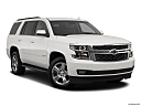 2019 Chevrolet Tahoe LT, front passenger 3/4 w/ wheels turned.
