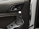 2019 Chevrolet Tahoe LT, second row side cup holder with coffee prop, or second row door cup holder with water bottle.