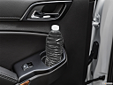 2019 Chevrolet Tahoe Premier, second row side cup holder with coffee prop, or second row door cup holder with water bottle.