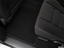 2019 Dodge Grand Caravan SE, rear driver's side floor mat. mid-seat level from outside looking in.