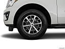 2019 Ford Expedition XLT, front drivers side wheel at profile.