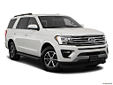 2019 Ford Expedition XLT, front passenger 3/4 w/ wheels turned.