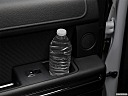 2019 Ford Expedition XLT, second row side cup holder with coffee prop, or second row door cup holder with water bottle.