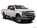 2019 Ford F-250 SD Lariat, front passenger 3/4 w/ wheels turned.