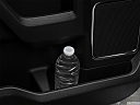 2019 Ford F-250 SD Lariat, second row side cup holder with coffee prop, or second row door cup holder with water bottle.