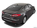 2019 Ford Fusion SE, rear 3/4 angle view.