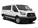 2019 Ford Transit Wagon 350 Low Roof XL, front passenger 3/4 w/ wheels turned.