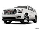 2019 GMC Yukon XL Denali, front angle view, low wide perspective.