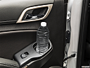 2019 GMC Yukon XL Denali, second row side cup holder with coffee prop, or second row door cup holder with water bottle.